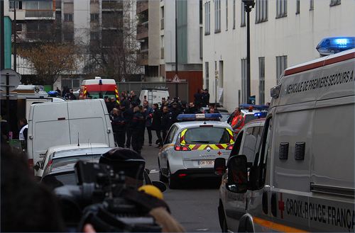 Outside- at the scene some two hours after the shooting.(Paris, France)